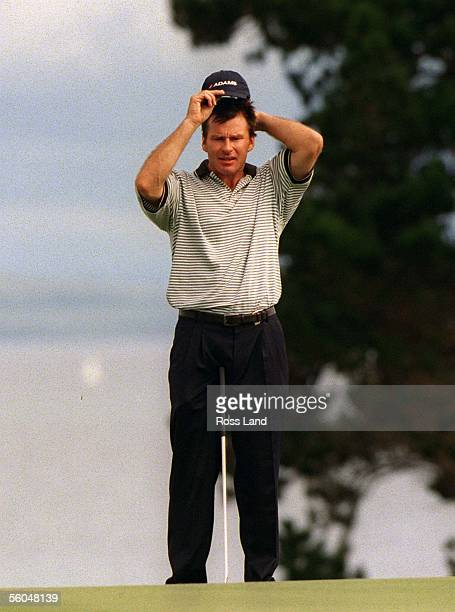 England's Nick Faldo adjusts his cap on a green at the World CUp of Golf, Gulf Harbour Country Club, Whangaparoa Peninsula.