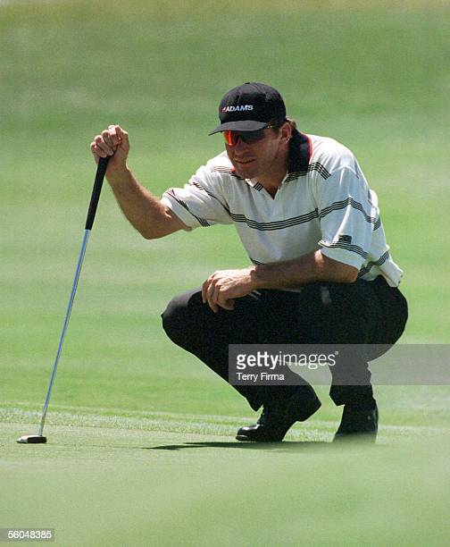 England's Nick Faldo lines up putt on the second day of the World Cup Of Golf at the Gulf Harbour Country Club, Whangaparoa Peninsula, New Zealand.