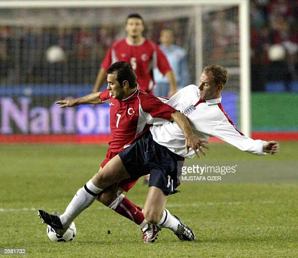 England`s Nicky Butt fights for the ball with Turkey`s Sergen Yalcin during their Euro 2004 qualifying match at Sukru Saracoglu stadium in Istanbul...
