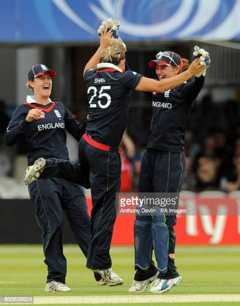 England's Nicky Shaw celebrates with Sarah Taylor after bowling out Nicola Browne during the Final of the Womens ICC World Twenty20 at Lords London