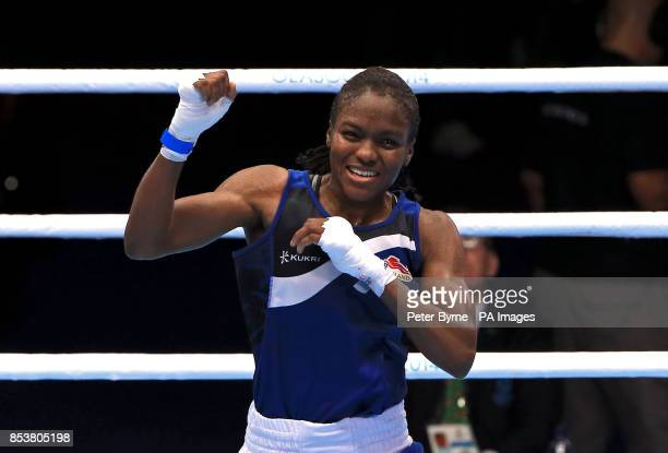 England's Nicola Adams celebrates beating Canada's Mandy Bujold in the Women's Boxing Fly Semifinal 2 at the SECC during the 2014 Commonwealth Games...