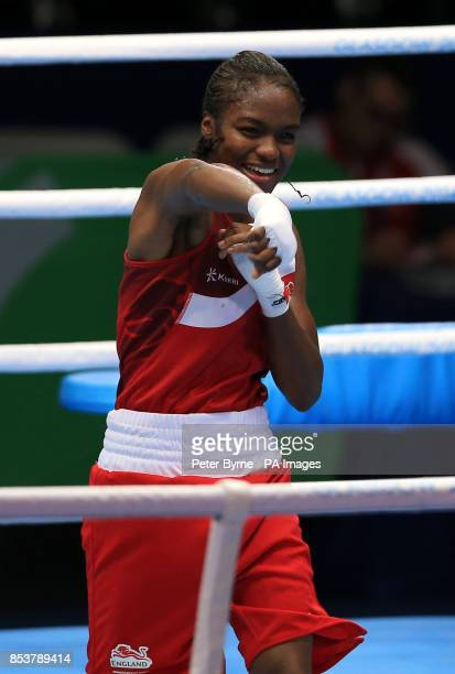 England's Nicola Adams celebrates her win against Sri Lanka's Erandi de Silva in the Women's Fly Quarterfinal 4 at the SECC during the 2014...