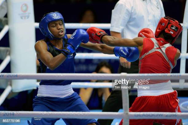 England's Nicola Adams fights Nigeria's Oluwatoyin in the fly event preliminaries at the SECC during the 2014 Commonwealth Games in Glasgow