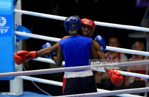 England's Nicola Adams hugs Sri Lanka's Erandi de Silva in the Women's Fly Quarterfinal 4 at the SECC during the 2014 Commonwealth Games in Glasgow