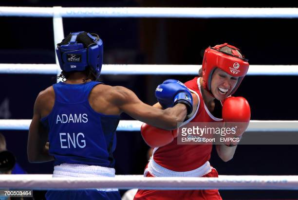 England's Nicola Adams in action against Canada's Mandy Bujold in the Women's Boxing Fly Semifinal 2 at the SECC during the 2014 Commonwealth Games...