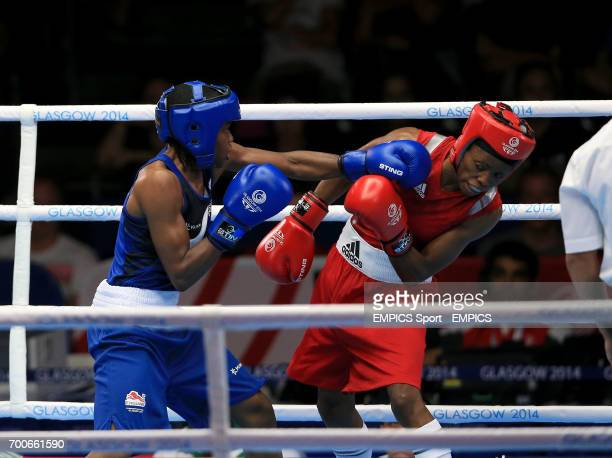 England's Nicola Adams in action against Nigeria's Oluwatoyin Oladeji in the Women's Fly Round of 16 at the SECC during the 2014 Commonwealth Games...