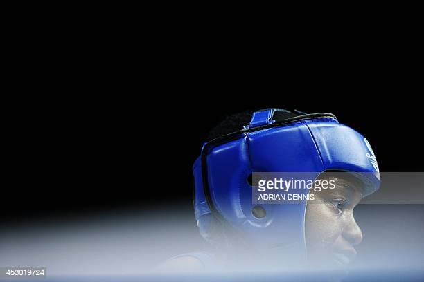 England's Nicola Adams looks on from the corner during her Womens Fly semifinal boxing match against Canada's Mandy Bujold during the 2014...