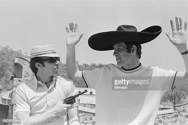 England's Nobby Stiles holding up teammate Peter Osgood with a pistol at the Rodeo in the old Olympic village. 11th May 1970.