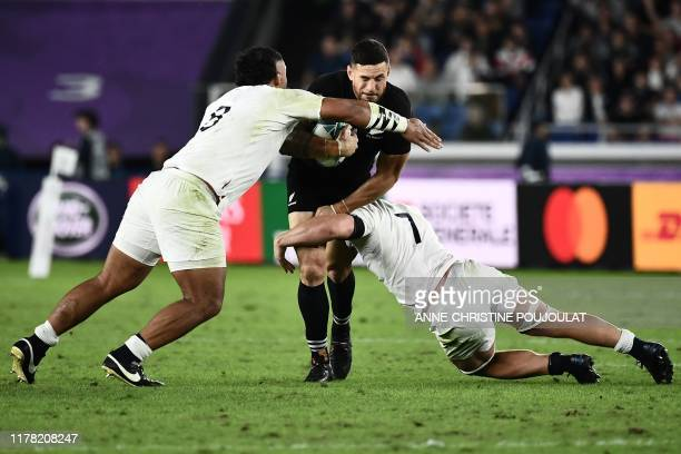 England's number 8 Billy Vunipola and England's flanker Sam Underhill tackle New Zealand's centre Sonny Bill Williams during the Japan 2019 Rugby...