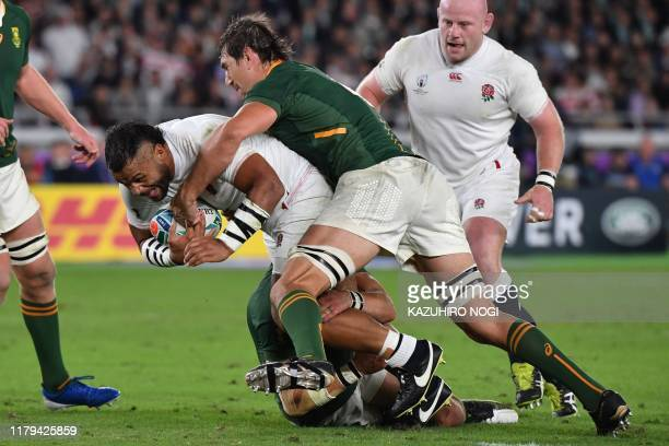 England's number 8 Billy Vunipola is tackled by South Africa's lock Eben Etzebeth during the Japan 2019 Rugby World Cup final match between England...