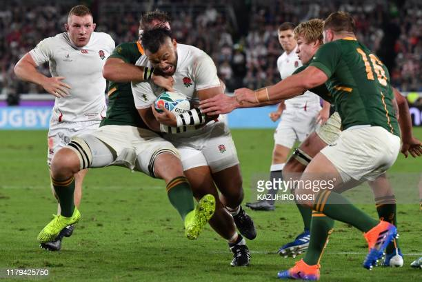 England's number 8 Billy Vunipola is tackled by South Africa's number 8 Duane Vermeulen during the Japan 2019 Rugby World Cup final match between...