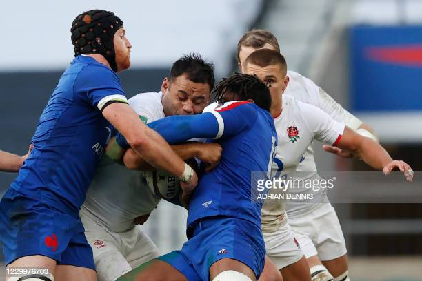 England's number 8 Billy Vunipola is tackled during the final of the Autumn Nations Cup international rugby union series between England and France...