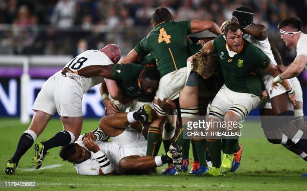 England's number 8 Billy Vunipola lies on the pitch during the Japan 2019 Rugby World Cup final match between England and South Africa at the...