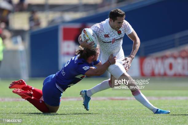 Englands Ollie Lindsay-Hague is tackled during the men's rugby semi-final match between England and France on day two of the World Rugby Sevens...