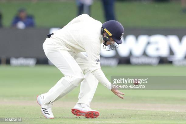 England's Ollie Pope attempts to cath the ball during the third day of the third Test cricket match between South Africa and England at the St...