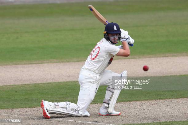 England's Ollie Pope hits a boundary during play on the first day of the third Test cricket match between England and the West Indies at Old Trafford...