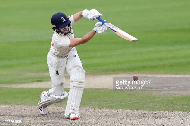 England's Ollie Pope plays a shot during play on the first day of the third Test cricket match between England and the West Indies at Old Trafford in...
