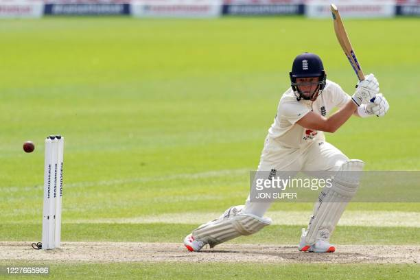 England's Ollie Pope plays a shot during play on the second day of the second Test cricket match between England and the West Indies at Old Trafford...