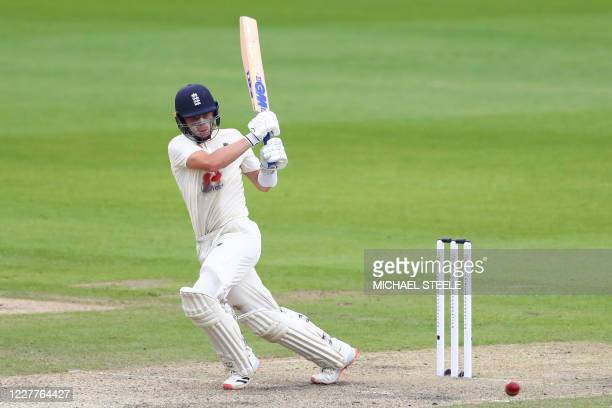 England's Ollie Pope plays a shot on the first day of the third Test cricket match between England and the West Indies at Old Trafford in Manchester,...