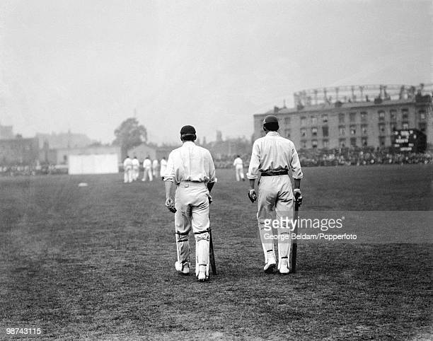 England's opening batsmen AC MacLaren and LCH Palairet walk out to bat during the 5th Test match between England and Australia at the Oval August...