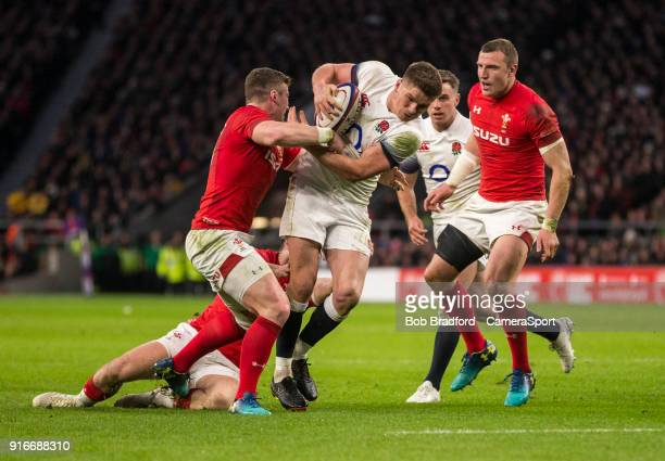 Englands' Owen Farrell is tackled by Wales' Scott Williams during the NatWest Six Nations Championship match between England and Wales at Twickenham...