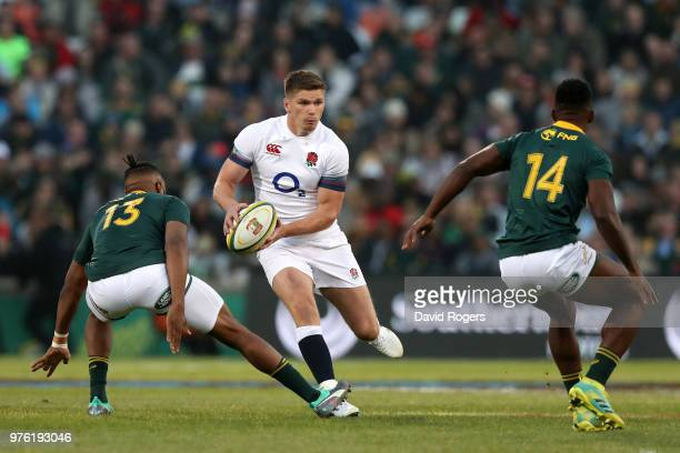 England's Owen Farrell looks to break the South Africa defence line during the second test match between South Africa and England on June 16 2018 in...