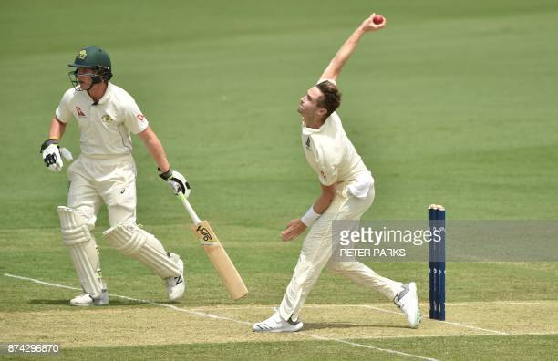 England's paceman Chris Woakes bowls to Cricket Australia XI batsman Matthew Short as Will Pucovski looks on during the first day of a fourday Ashes...