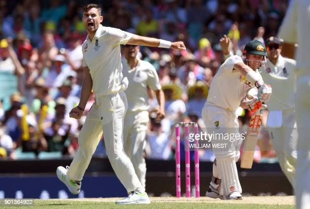 England's paceman James Anderson celebrates after dismissing Australia's batsman David Warner on the second day of the fifth Ashes cricket Test match...
