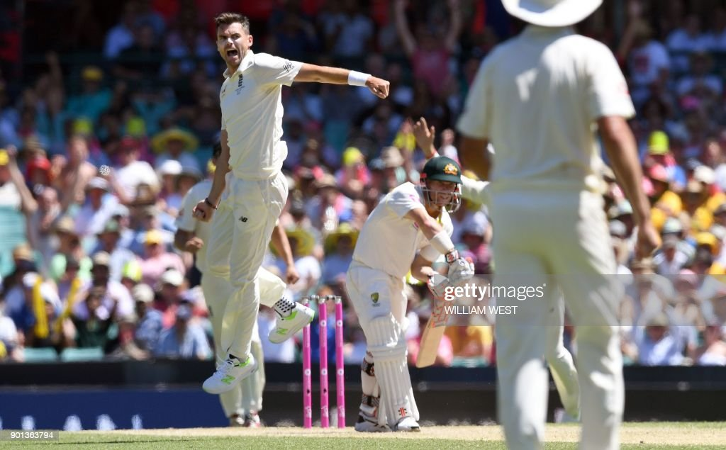 England's paceman James Anderson (C) leaps in the air as he dismisses Australia's batsman David Warner (R) on the second day of the fifth Ashes cricket Test match at the SCG in Sydney on January 5, 2018. /