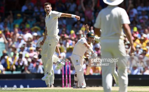 England's paceman James Anderson leaps in the air as he dismisses Australia's batsman David Warner on the second day of the fifth Ashes cricket Test...