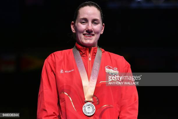 England's Paige Murney poses with her silver medal during the medal ceremony for the women's 60kg boxing event during the 2018 Gold Coast...