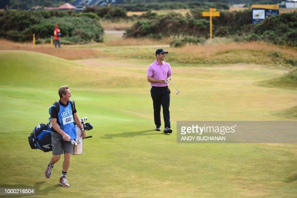 England's Paul Casey and his caddie John McLaren share a joke during a practice session at The 147th Open golf Championship at Carnoustie Scotland on...