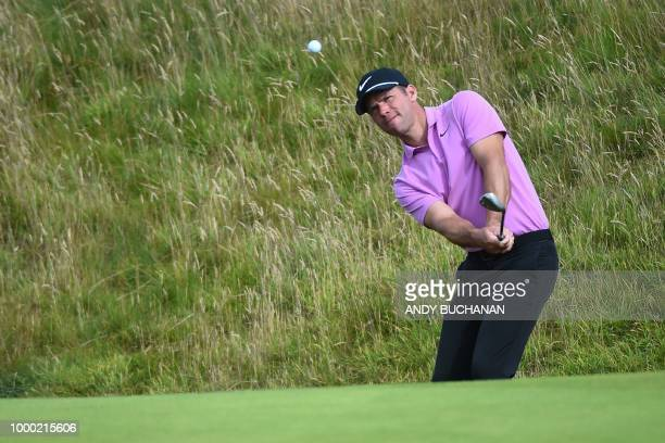England's Paul Casey chips onto the 17th green during a practice session at The 147th Open golf Championship at Carnoustie Scotland on July 16 2018