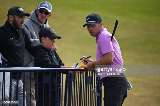 England's Paul Casey signs an autograph for a fan during a practice session at The 147th Open golf Championship at Carnoustie Scotland on July 16 2018