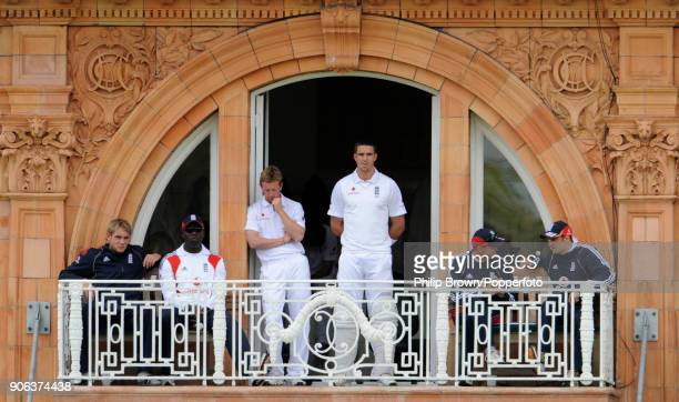 England's Paul Collingwood and Kevin Pietersen watch the match from the England dressing room balcony with Stuart Broad bowling coach Ottis Gibson...