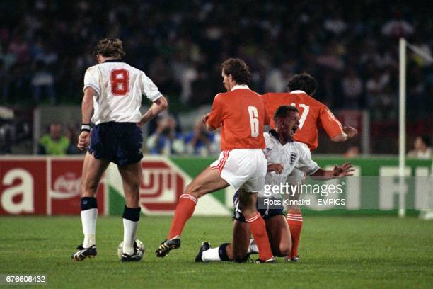 England's Paul Gascoigne is tackled by Netherlands' Hans GILLHAUS and Jan WOUTERS watched by England's Chris Waddle