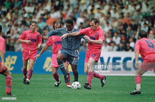England's Paul Ince is challenged by Dave Watson of Hong Kong Golden Select XI in a Century Challenge Cup match at the Happy Valley Stadium Hong Kong...