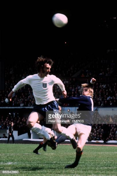 England's Paul Madeley clashes with Scotland's Denis Law