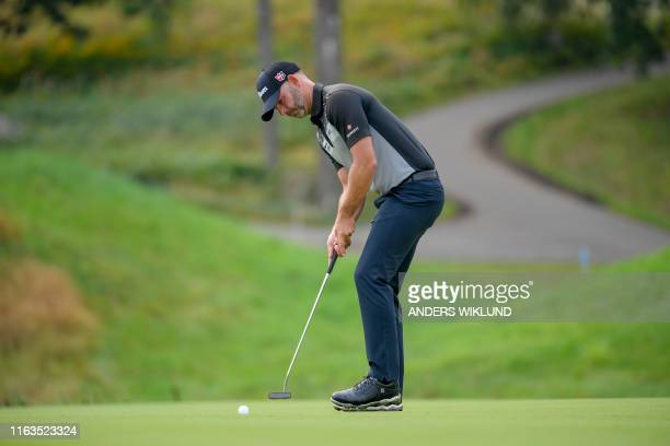 England's Paul Waring putts on the second hole during round three of the PGA European Tour golf tournament Scandinavian Invitation at Hills Golf and...
