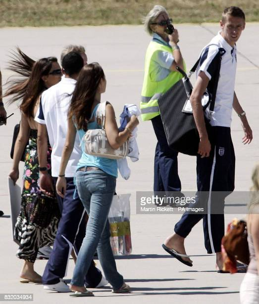 England's Peter Crouch and wives and girlfriends board the plane at Baden Airport Germany for the journey back to England Picture date Sunday July 2...