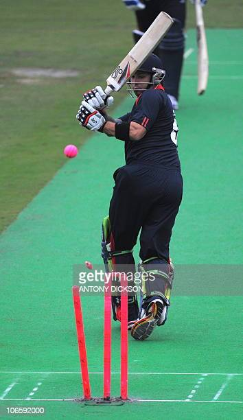 England's Peter Trego looks back to see his bails falling to the ground after being clean bowled by a Hong Kong bowler in the Hong Kong Cricket Sixes...