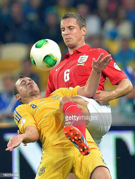 England's Phil Jagieka fights for a ball with Ukraine's Roman Zozulya on September 10 2013 during a 2014 FIFA World Cup group H qualifying football...