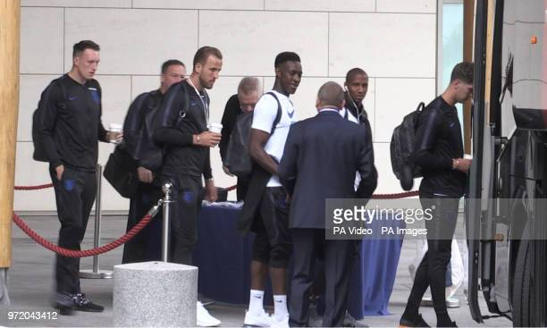 England's Phil Jones Harry Kane Danny Welbeck Ashley Young and John Stones prepare to board the bus at St George's Park in Burton ahead of flying out...