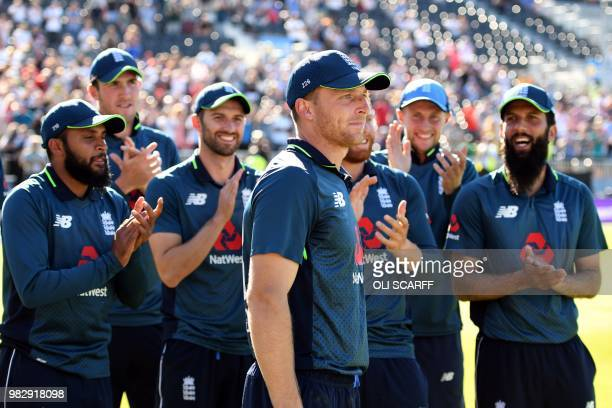 England's player Jos Buttler is applauded by teammates before being awarded Man of the Match and the Man of the Series accolades after the fifth One...