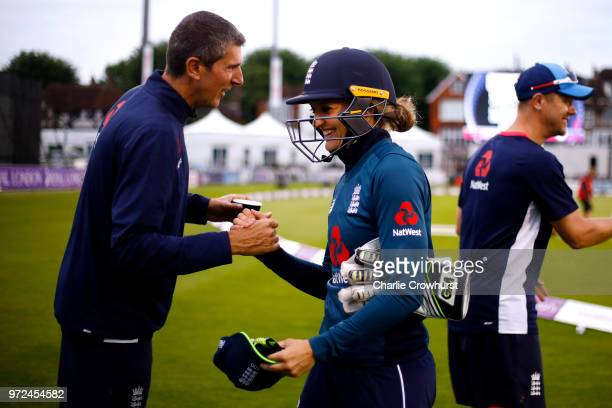 England's player of the match Sarah Taylor celebrates the teams win with head coach Mark Robinson during the ICC Women's Championship 2nd ODI match...