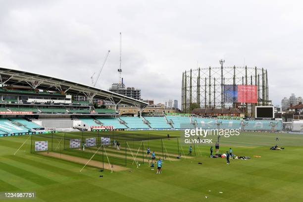 England's players attend a practice session ahead of the fourth Test match between England and India at The Oval cricket ground in London, on...