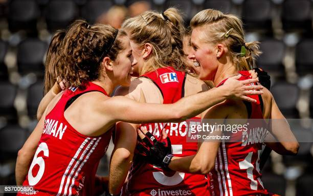 England's players celebrate after scoring against Scotland during the Women's Hockey Rabo EuroHockey Championships match in Amstelveen in The...