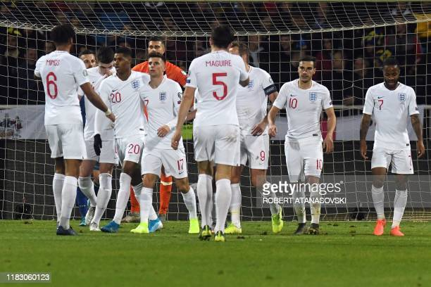 England's players celebrate after scoring their winning goal during the UEFA Euro 2020 qualifying Group A football match between Kosovo and England...