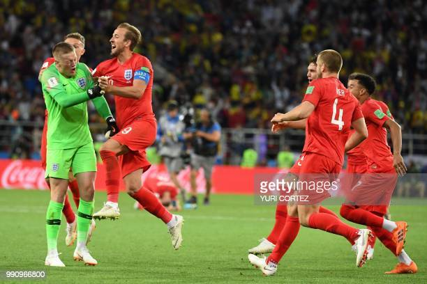 England's players celebrate after winning the penalty shootout at the end of the Russia 2018 World Cup round of 16 football match between Colombia...