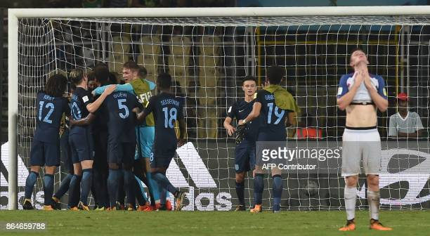 England's players celebrate after winning the the quarterfinal football match between USA and England in the FIFA U17 World Cup at the Jawaharlal...